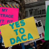 """""""Yes to DACA"""" and other protest signs,  Santa Cruz Women's March, March 2017"""