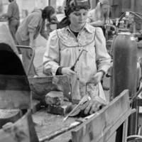 Art Board: student welding a sculpture. 1975.