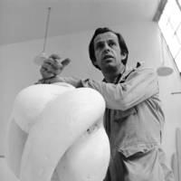 Jack Zajac, professor of art, with a sculpture. 1970.