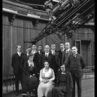 """Lick Observatory staff, in a group portait by the 36-inch refractor, the """"Great Lick Refractor."""" Circa 1922"""