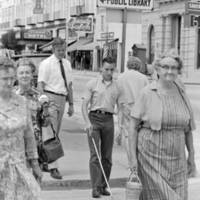 University Extension course for blind students: unidentified student and instructor in downtown Santa Cruz on Pacific Avenue. 1969.