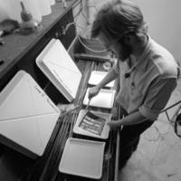 College Five Photography Guild: student working in a photo lab. 1970.