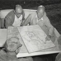 University of California, Santa Cruz planning: Gordon Sinclair, Sentinel managing editor (top left), Chancellor Dean McHenry,  engineer Tom Polk Williams Jr., (lower left), and Jack Wagstaff, university architect, inspecting the site and early plans. 1961.