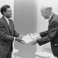Jonathan Fifi'i of the Solomon Islands, research assistant to anthropologist Roger Keesing, presents a tribal baton to Chancellor McHenry. 1966.