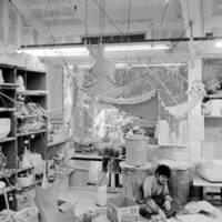Robert L. Strini, assistant professor of art, sculpture class: student with art work. 1977.