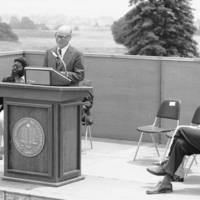 College 7 (Oakes College) dedication: retired chancellor Dean McHenry at the podium with Daniel Koshland, Sr., Herman Blake, Chancellor Mark Christensen, and unidentified woman