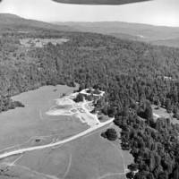 UC Santa Cruz aerial photograph: College V construction view, with the Santa Cruz Mountains in the distance