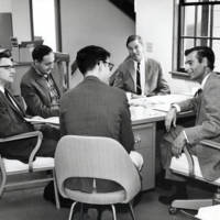 Cowell College Library Committee: Stanley Williamson, chemistry; John Dizikes, history; Richard Mather, history; Gabriel Berns, Spanish, and George Amis, English (back to camera). 1965.