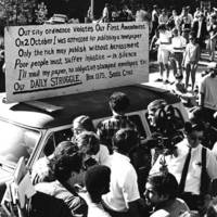 Protest against US Air Force recruiters at UC Santa Cruz: crowd of students around a car. Circa 1966.