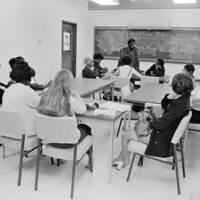 Herman Blake's Junior Leadership Program: Blake with students in a classroom. 1969.