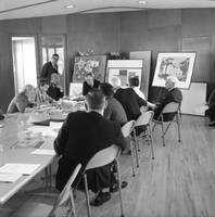 University of California, Santa Cruz, dedication events: presentation of the Preliminary Master Physical Plan to the regents, at the First Congregational Church social hall on High Street: architect Ernest Kump (standing, left background), Clark Kerr, Donald McLaughlin (right) and other participants. 1964.